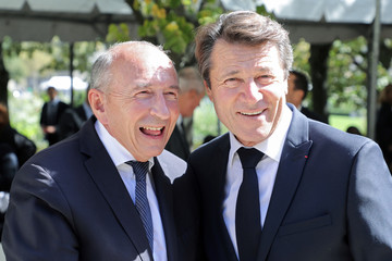 French Interior minister Gerard Collomb poses with the Mayor of Nice Christian Estrosi during a national ceremony to pay tribute to the victims of militant attacks, in Paris