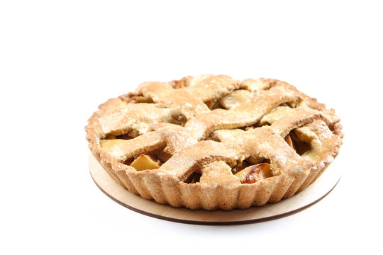 Traditional American Thanks Giving lattice pie isolated on white background. Homemade fruit tart baked to golden crust. Close up, copy space, top view.
