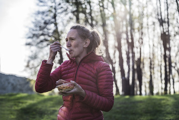 Woman eating in natural setting