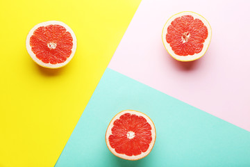 Ripe grapefruit slices on colorful background
