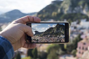 Tourist photograph town of Taormina, Sicily, Italy