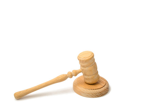 A judge hammer on a white background. Court and judgment. Justice and legality. Legislators, public administration. Auction for the sale of property and real estate, art. Crime.