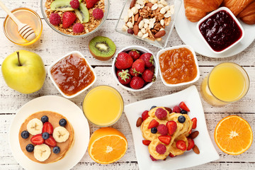 Fresh and tasty breakfast on kitchen wooden table