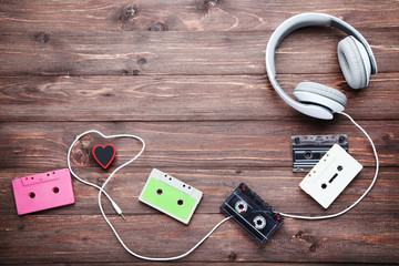 Headphones and cassette tapes on brown wooden table