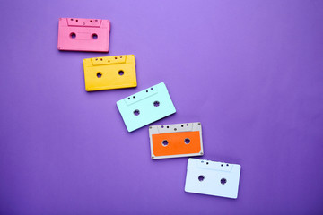 Colorful cassette tape on purple background