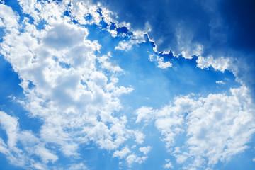 white fluffy clouds in a blue sky, clouds