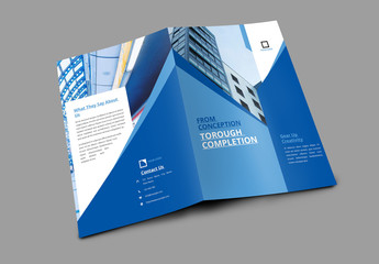 Bifold Brochure Layout with Geometric Elements and Blue Accents