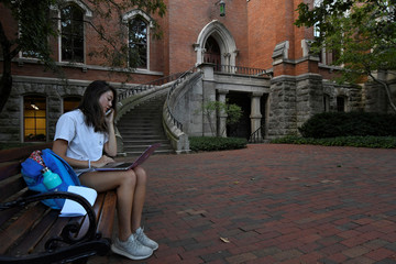 Devyn Zaminski, a sophomore, prepares for class near Kirckland at Vanderbilt University in Nashville
