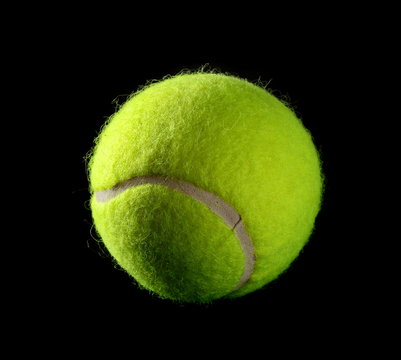 New tennis ball isolated on black background