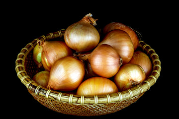 Basket of Fresh Onions on a Black Background