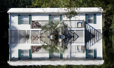 Water from the flooded Waccamaw River surrounds a house in the aftermath of Hurricane Florence now downgraded to a tropical depression in Conway
