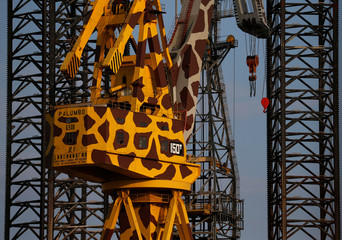 """A crane is seen painted as a giraffe in an art installation by artist Twitchcraft as part of the visual arts exhibition """"The Island is What the Sea Surrounds"""" at the Palumbo Malta Shipyard in Cospicua"""
