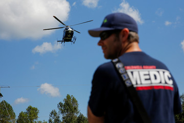 A member of Mobile Disaster Hospital watches the chopper depart from their treatment unit in the aftermath of Hurricane Florence now downgraded to a tropical depression in Kinston, North Carolina
