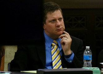 Chicago police officer Jason Van Dyke listens to attorneys during his trial for the shooting death of Laquan McDonald at the Leighton Criminal Court Building in Chicago