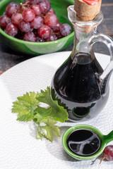 Black aged natural balsamic vinegar dressing from Modena, Italy