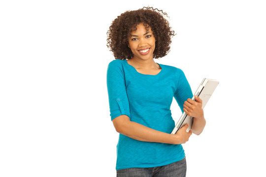 Young millennial black college student holding laptop on white background