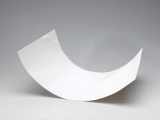 a sheet of paper half rolled