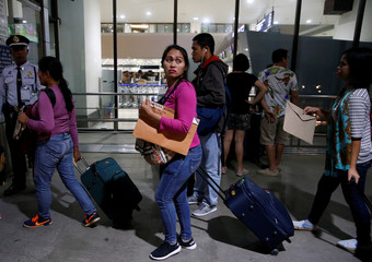 OFWs queue to enter Ninoy Aquino International Airport in Pasay