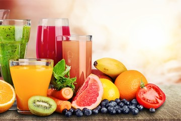 Foto op Plexiglas Sap Composition of fruits and glasses of juice