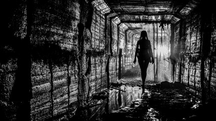 Silhouette of a young slender girl in a storm drainage shaft