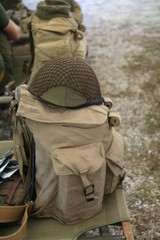backpack and military helmet of the second world war on the cot