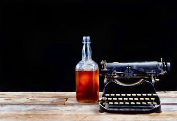 Antique Typerwriter and Whisky Bottle.