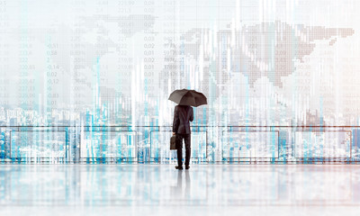 Elegant businessman standing with back and looking at modern business cityscape. Mixed media