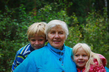 happy grandmother and grandkids enjoy being together in nature
