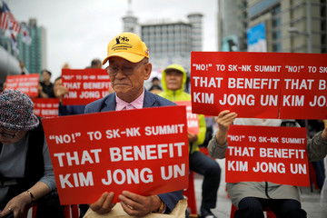 Members of a South Korean conservative and right-wing civic group take part in an anti-North Korean leader Kim Jong Un protest in Seoul