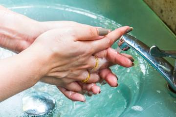 Woman handwashing
