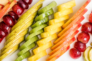 Eat a Colorful Variety of Fruits every Day for Better Health. colorful of sliced fruits.
