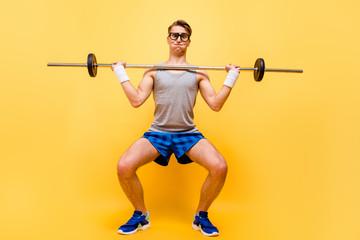 Full length body size of funky caucasian guy in glasses, doing p