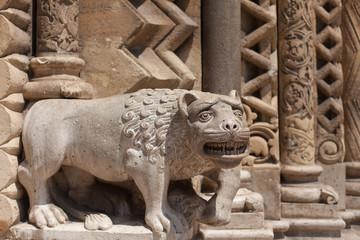 sculpture of a lion near a Gothic temple