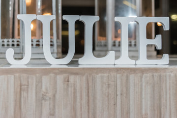 JULIE Name made of large white blocks style font for a Baptism Party
