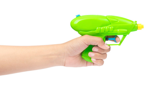 hand holding toy Plastic water gun isolated on white background