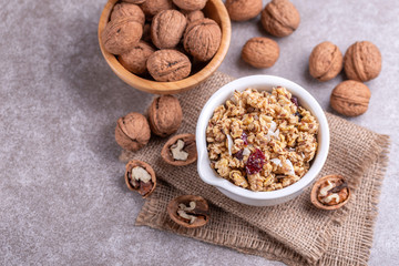 Bowl of homemade granola with nuts. Copy space