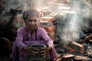 Old woman Vietnam doing traditional pottery production in Phu Lang village,Bac Ninh province,Vietnam.