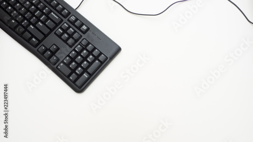 Wall mural Office desk table with keyboard black Top view on white background