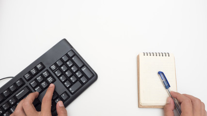 Canvas Print - Office desk table with keyboard black and notebook Top view on white background