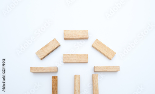 Wall mural wooden block concept house on white background