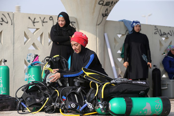 Abrar Abu Abdullah, a Saudi female diver prepares her diving equipment at Half Moon Beach open-water dive site in Dhahran