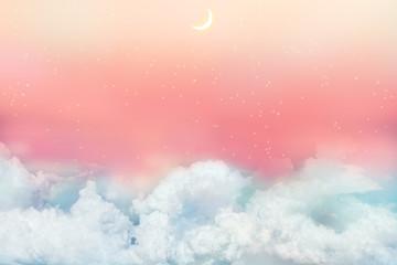 夕焼けと星空に浮かぶ雲と新月