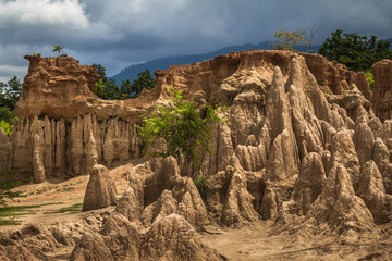 Intriguing and picturesque landscape of  eroded sandstone pillars, columns and cliffs, natural erosion of water and wind, Sao Din Na Noi National Park in Nan Province, Thailand