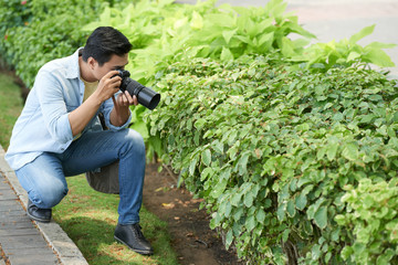 Photographer taking marco photos of camera with special lens