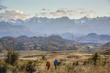 hikers at Chacabuco Valley with a view over the Jeinimeni Mountain peaks, Parque Patagonia, AysŽn Region, Chile.