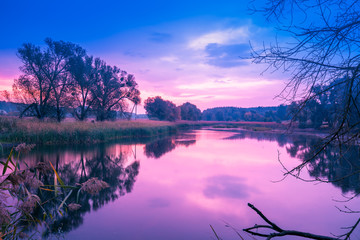Photo sur Plexiglas Lilas Magical sunrise over the lake. Misty morning, rural landscape