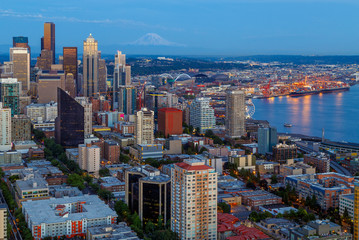 Seattle skyline panorama in blue hour with Mt. Rainier in background as seen from Space Needle Tower, Seattle, Washington, USA. Travel USA.