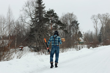 man in winter with axe