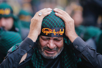A Lebanon's Hezbollah supporter mourns Imam Hussein during last day of Ashura in Beirut