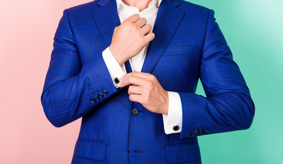 Detail make outfit elegant. Male fashion. Perfect to last detail. Male hand check button on shirt sleeve. Cufflinks match with luxury classic suit jacket. Make sure outfit and appearance look perfect